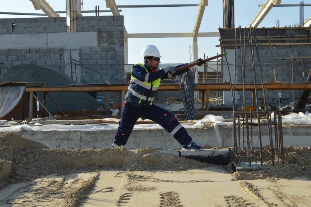 man on construction site high visibility clothing